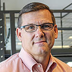 JIM HILL, EXECUTIVE VICE PRESIDENT & GENERAL MANAGER, MID-MARKET